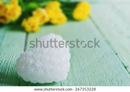 white decorative heart on green wooden background. holidays and events. selective focus - stock photo