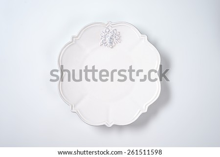 white decorative plate on white background - stock photo