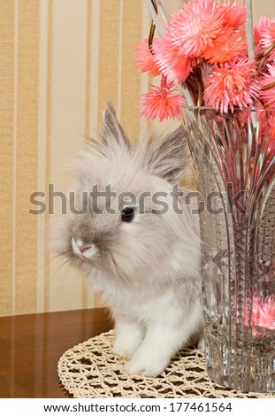 White decorative rabbit and pink flowers