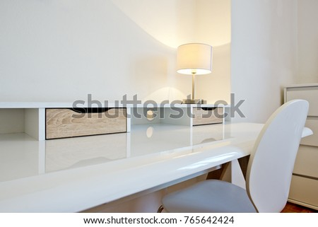 White desk and chair in a clean, modern apartment