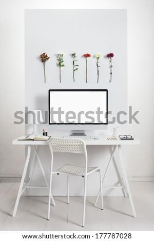 White desk with spring environment. - stock photo