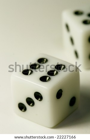 white dice against white background vertical - stock photo