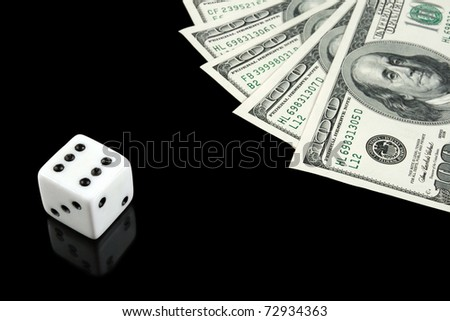 White dice and US money on black background. Gambling concept. - stock photo