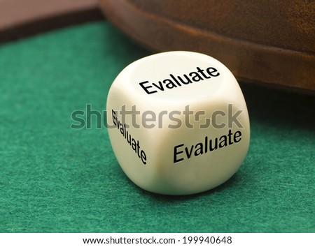 white dice - Evaluate - stock photo