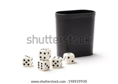 White dices and cup isolated on white. - stock photo