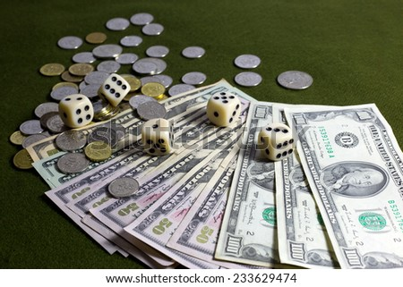 White Dices, Coins and American Dollar Bills on Green Table - stock photo