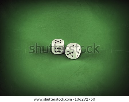 white dices on green table - stock photo