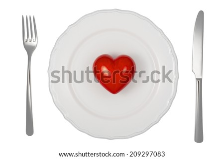 White dinner plate with red heart and on it and cutlery,  isolated on white background. Studio shot.