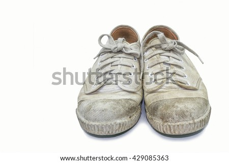 White dirty shoes isolate on white background