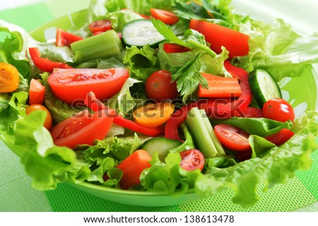 white dish of salad with fresh vegetable on green napkin