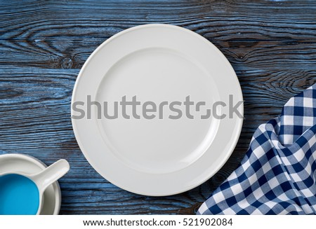 white dish on blue wood table,mediterranean living background