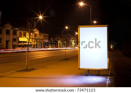 white display advertising with traffic at night 3 - stock photo