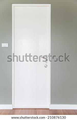 White door and Gray wall - stock photo