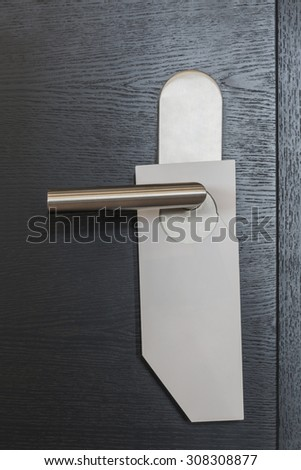 White door hanger without text on modern black door