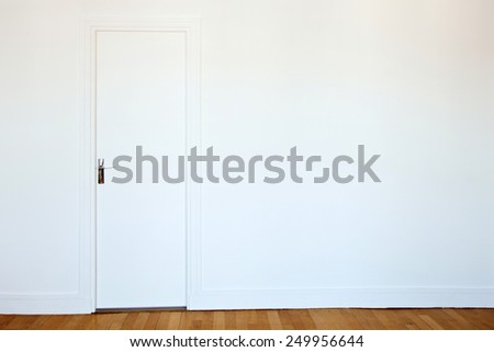 white door on white wall, real estate background - stock photo