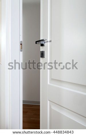 white door open on a grey background