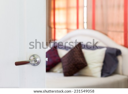 white door open to cozy bedroom , white bed, brown curtain / asian modern living style - stock photo