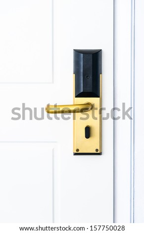 white door with an electronic lock and handle of gold color - stock photo