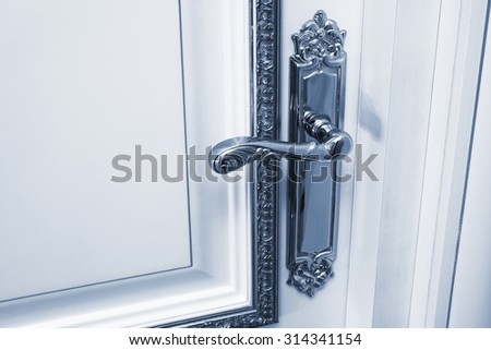 white door with the old handle - stock photo