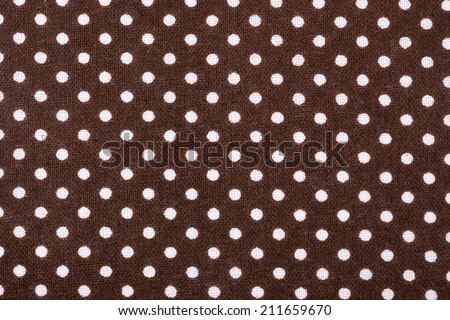 white dots on grey textile cloth - stock photo