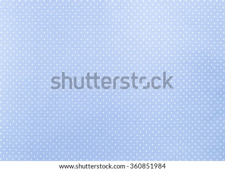 White dots over blue fabric background and texture - stock photo