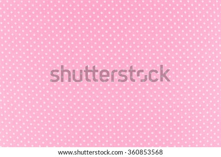 White dots over Pink Polka dot fabric background and texture - stock photo
