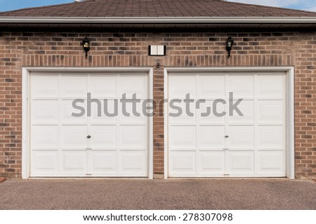 White double garage - stock photo