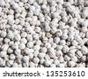 White dragee, sugar covered nuts background - stock photo
