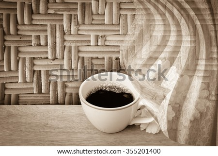 white drapery on black coffee and bunch of flower with surface of woven background - stock photo