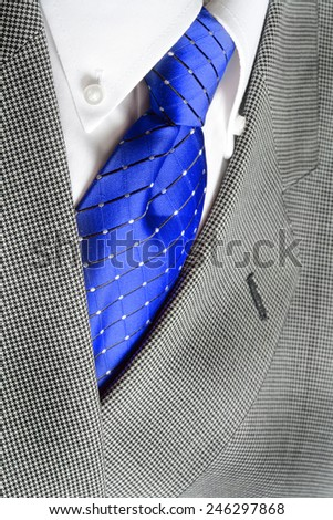 White dress shirt with blue tie and suit jacketdetailed closeup - stock photo