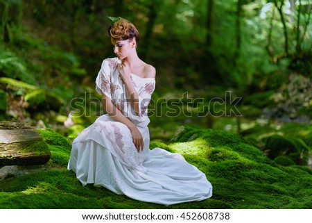 White dressed woman in the green forest