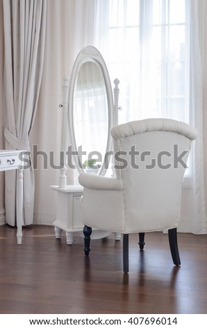 white dressing table with classic chair aand elegance mirror in luxury bedroom design - stock photo