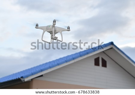 white drone fly above home roof asia.