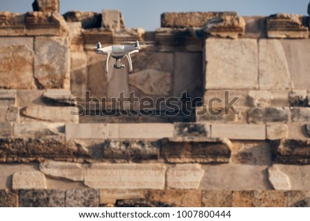 "White Drone Flying in front of Ancient Ruin of Greek and Roman City Named ""Hierapolis"" the Holy Hot Springs City over Pamukkale, Denizli Turkey"