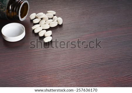 white drugs and pills on the table - stock photo