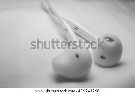 White earphones - stock photo
