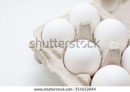white eggs on a white background  - stock photo