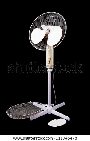 white electric broken fan isolated on black background