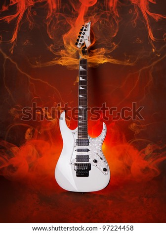 White Electric Guitar Burning  in Flame and smoke - stock photo