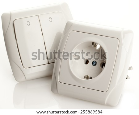White Electric Socket and Switch on White background.