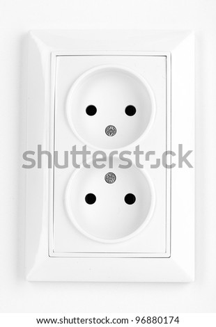 White electric socket on the wall - stock photo