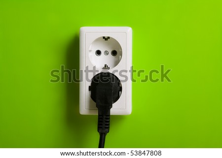 White electric socket on the wall. Close up. - stock photo