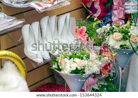 White elegant wedding shoe in a weddingstore