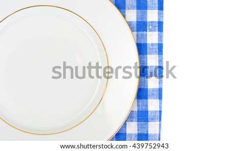 White Empry Plate on a Tablecloth with Place for Your Text Studio Photo