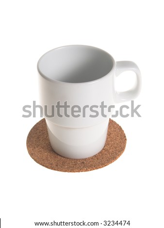 White empty coffee of tea cup on a cork pad taken from above isolated on white - stock photo