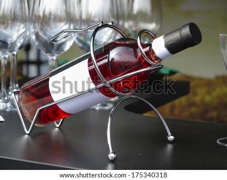 White empty label wine bottle in metallic support - stock photo
