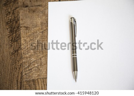 White empty  paper and pen on wooden table ,waiting for inspiration  - stock photo