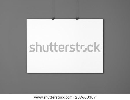 White empty paper with clips on the black wall