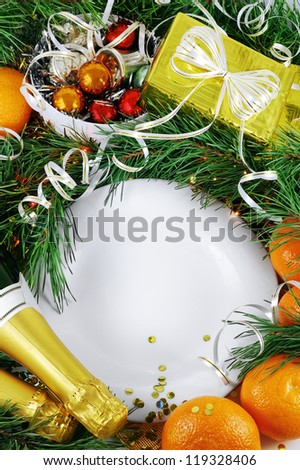 White empty plate in the Christmas decorations top view.