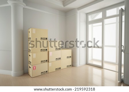 White empty room in old house with moving boxes - stock photo